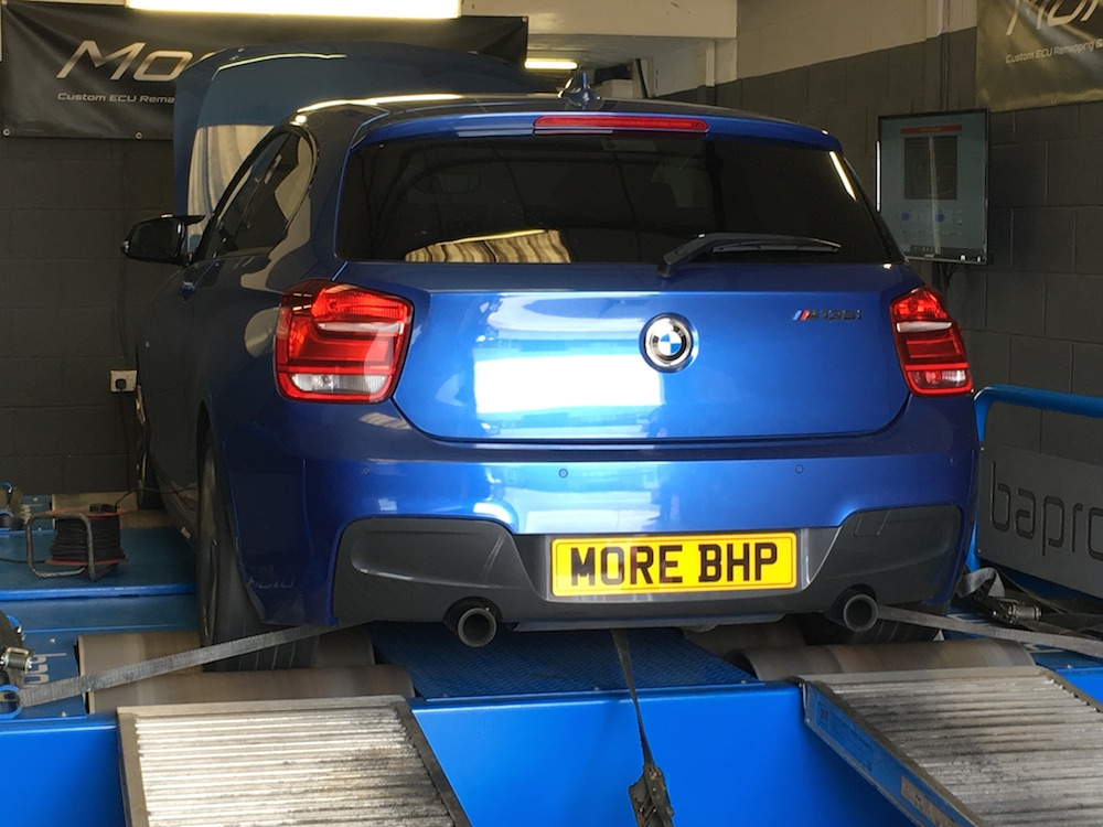 A BMW M135i being remapped on the MoreBHP rolling Road in Crewe